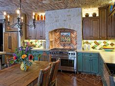For a rustic spanish style look, mix a variety of colors and patterns throughout the kitchen. Read on for more two-tone kitchen cabinet tips and ideas. Home Decor Kitchen, Rustic Kitchen, Country Kitchen, Home Kitchens, Kitchen Ideas, Ivory Kitchen Cabinets, Traditional Kitchen Cabinets, Wood Cabinets, Kitchen Countertops