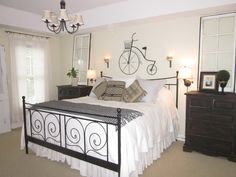 White sheer curtains on simple black rods with rings