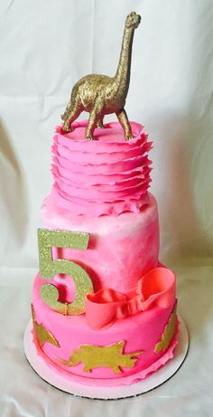 Pink and gold girly girl dinosaur cake fifth birthday cake