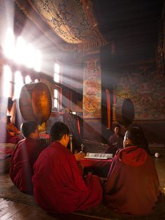 Tibetan monks... love the light in this photo