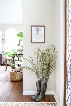 I love the flowers in rain boots! What a beautiful home with light touches of greenery perfect for spring or summer | maisondepax.com
