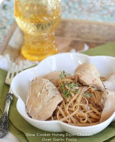 Slow Cooker Honey Dijon Chicken Over Garlic Pasta.