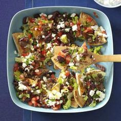 Mediterranean Nachos Recipe ~ Make a Mediterranean version of nachos using crisped pita wedges topped with ground lamb or beef, feta cheese and a creamy cucumber sauce