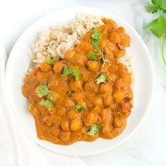 A Healthy Butter Chickpeas recipe made gluten free and vegan with chickpeas, curry powder, tomato sauce, coconut milk and a very secret ingredient.