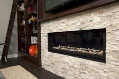 Truberry 716 by BIA Parade of Homes Photo Gallery, via Flickr BEAUTIFUL stacked stone fireplace with TV above