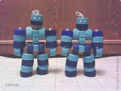 Роботы из крышек фото 1