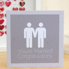 A bold male same sex wedding card.  Designed and handmade by us, our contemporary and unique 'You're Married!' with two gents card is a fun, bold and eye-catching square design.