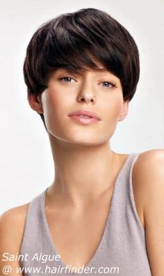 Short Brunette Hairstyle With The Layers And A Very Short Neck Section.