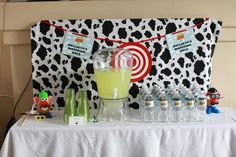 Toy Story Party - love the Bullseye watering hole idea for all the drinks. Also love the logo for the water bottles and sign.