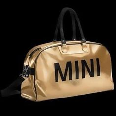 MINI duffle bag Brand new golden MINI bag with black letters. Good for alternative over night bag or even a place to hold office materials (no trades) Mini Cooper Bags