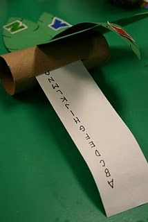tp tube turned into chicka tree and has a rolled up sentence strip with alphabet inside, students can pull it out to review or retell story.