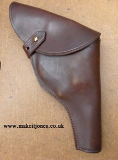 Custom made, hand dyed, hand sewn replica of the Indiana Jones holster from Raiders of the Lost Ark. Sized to hold barrel S&W revolvers. Handmade in the UK from Makeitjones. Pistol Holster, Revolvers, Leather Projects, Indiana Jones, Leather Working, Raiders, Hand Sewn, Barrel, Sunglasses Case