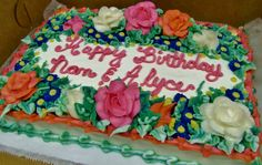 Buttercream cake with flowers around edges and message in center of sheet cake.