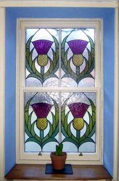 Thistle stained glass panel seen from  inside