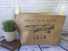 life is better at the lake tote,large lined burlap storage basket , burlap storage tote, lake house by MinnieandMaude on Etsy Tote Storage, Storage Baskets, Craft Storage Cabinets, Poly Bags, Ink Color, Beach Towel, Paper Shopping Bag, Life Is Good, Burlap
