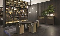 Poliform|Varenna _ Wall System bookshelf with integrated led lighting. Canova table. Guest chairs.