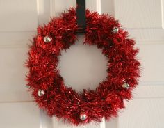 D.I.Y. Holiday Tinsel Wreath:   a tinsel garland – any color  foam wreath form  tape  bells on a string or tied with thread – optional