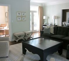 An extra-large coffee table with a feminine shape is the modern take on the traditional game table.