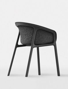 Beautiful chair design with charcoal grey felt seat.