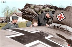 This colorized picture is typically identified as a Bf 109 G-2 III./JG52 'Battle of Stalingrad' from the late Summer 1942. As Raja pointed out below, that indeed is the emblem of the third Staffel of the Gruppe. I incorrectly thought that it might be a Regia Aeronautica symbol, but the two just bear a (to my eyes, anyway) close resemblance.