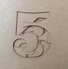 5 - overlaid number cutouts... either layer inlays or cutout shapes in veneer and ply-layer them together