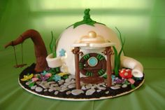 Tinkerbells Teapot House - This is the second time I've made this cake, but this time it was for my little girl and I went into more detail! :) Chocolate fudge cake with chocolate ganache, decorations are fondant and gumpaste- the only thing non-edible is the inside of the teapot lid supports and the swing strings.