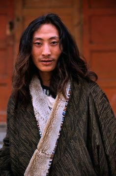 Tibetan man, Kham, Eastern Tibet.Alison Wright photography.    His hair is beautiful.