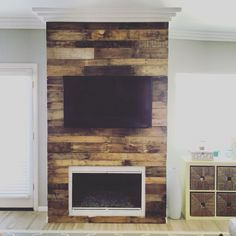 diy reclaimed wood wall a little high heat spray paint and locally reclaimed pallet wood