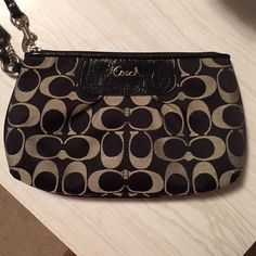 Coach Wristlet Black and Grey Coach Wristlet. Never carried. Perfect Condition.  If you'd like to make an offer please do so through the offer feature not the comments. Thanks!! Coach Bags Clutches & Wristlets