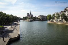View of the Notre Dame Cathedral, sitting surrounded by the River Seine. You may be interested in more; www.eutouring.com/images_river_seine.html