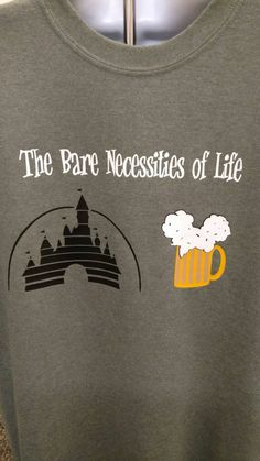 Its just the Bare Necessities the SIMPLE BARE NECESSITIES...All you need in life is Mickey ears and Cold beer!! *Please note: The shirt color in the listing image is Military Green. When choosing PRIMARY COLOR you are choosing the shirt color. Also available in womens shirts,colors