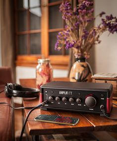 My amp: Line 6 AMPLIFi TT desktop amp modeler product photo with Android device. Great functions but app needs much more work.