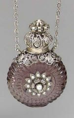 Amethyst Perfume Bottle Necklace -  Bottle is a deep purple color, encased with silver tone filigree and adorned with faux pearls.  Filigree screw on top, accented with faux pearl.
