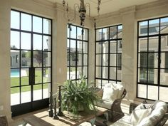 With a steel French door and three French casement windows – this sunroom surely breathes!