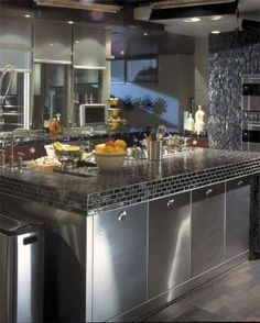 I love the modern elements in this kitchen. The wall ovens and the extended faucet with the sprayer...that tile. This is lovely