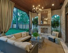 Perfect example of an outdoor extension of your home even down to the chandelier and the curtains, would you ever go inside?