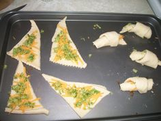 Cheese & Veg Crescents  -Easy way to get my toddler to eat a massive amount of veg.   -I steam any veg for a few min longer than normal  -chop up fine  -roll up with cheese  -POOF! 20 month old chows down.