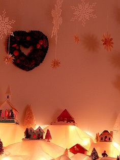 I LOVE this bloggers idea of the Christmas Village on the mantle..,,,. Hmm- I've always put mine on the piano but....