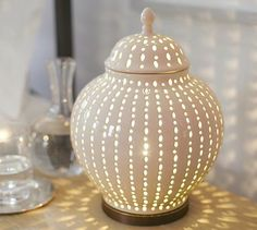 This would be good in a higher place, like on top of a  wardrobe or bookshelves for soft accent lighting: Perforated Ceramic Jar Accent Table Lamp #potterybarn
