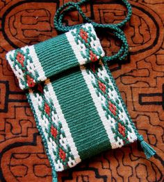 Tutorial – A yurt band border in two-color warp floats - This is a tutorial for weaving designs using two colors of alternating simple warp floats. Here I will show you how to weave the border design from a yurt band which you can see below. Inkle Weaving Patterns, Weaving Designs, Weaving Textiles, Weaving Projects, Loom Patterns, Stitch Patterns, Knitting Patterns, Card Weaving, Weaving Art