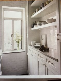 Great idea for my butler's pantry...white subway tile, stainless steel counter top, drawers, shelves...just, WOW!