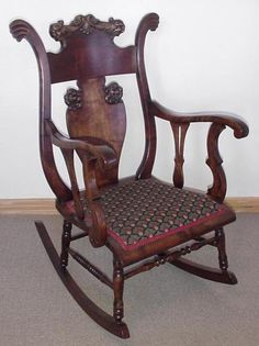 Victorian Mahogany Rocking Chair w/ Lion Heads.