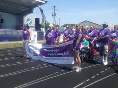 Medals4Mettle presenting medals to cancer survivors at the Capac Relay 4 Life.