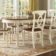 Oval table. This is what I want to do with our black chairs and oval table except the chairs will be completely white and we have a pedistal table