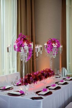 clear candelabras with draping flowers