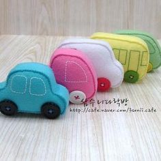 felt cars. I wonder if my boys would play with them over their real toy cars...