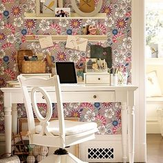 I really love this wall paper that is removable...want to redo the master bedroom with this on the back wall...LOVE the pops of pink.