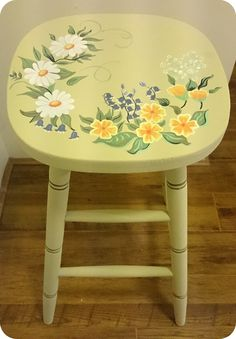 A beautiful little stool I have hand painted here at Rua Dublin using Chalk Paint™ by Annie Sloan, The base colour I have used is Versailles and I have hand painted all of the flowers also using Chalk Paint