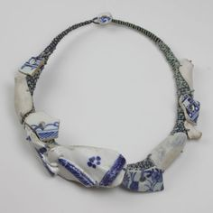 (I've always loved blue and white pottery and have saved broken pieces myself, to use for jewelry... this is an interesting idea for it)  Necklace | Amanda Caines. Suffolk dump dig pottery figure with Thames