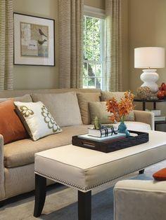 tan sofa, tan walls and a little color